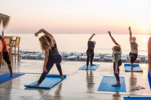 Yoga class by the beach