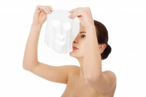 Woman using a collagen mask