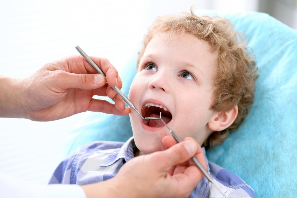 a kid at the dentist
