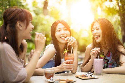 Women having drinks outdoors