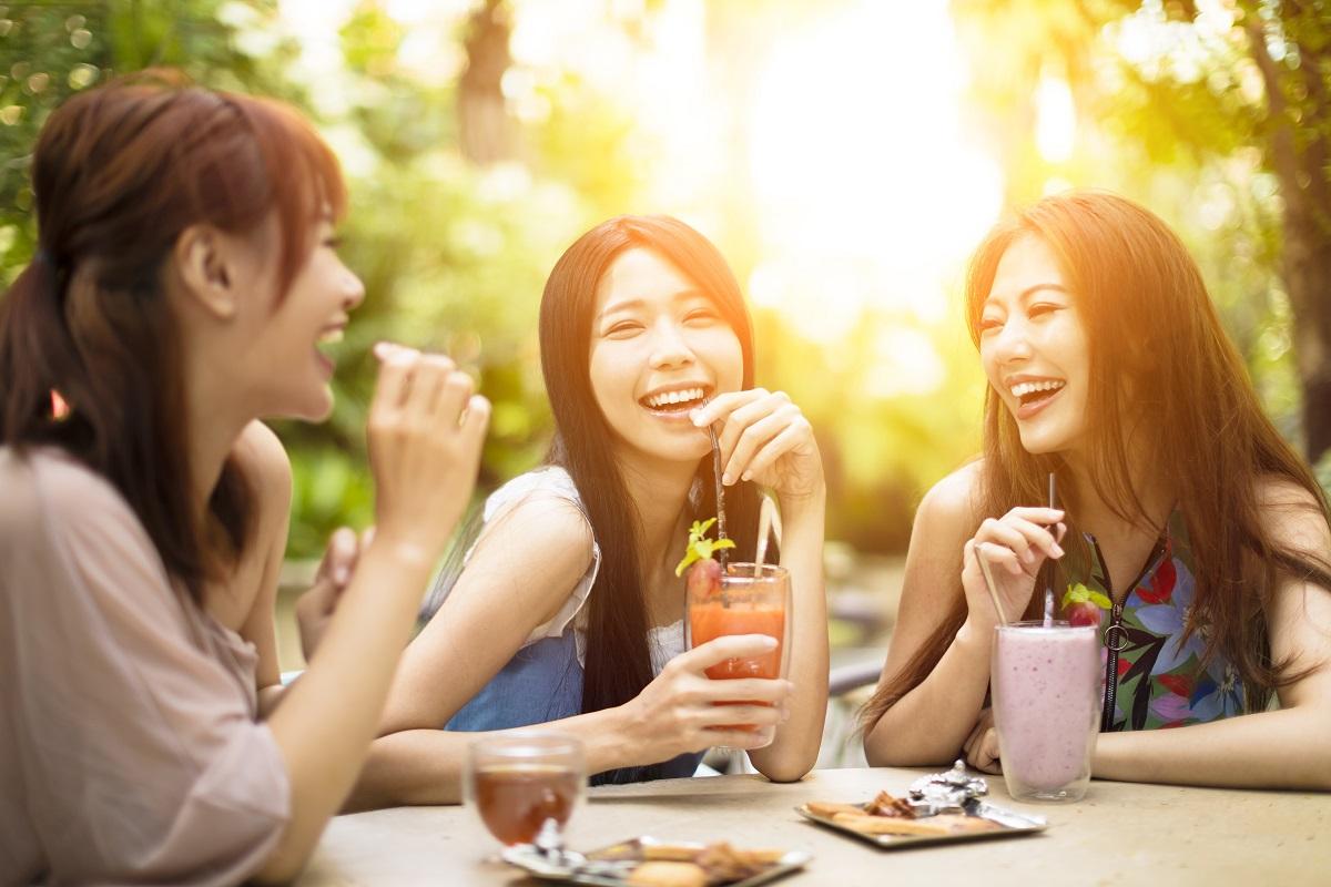 Women having drinks outdoors