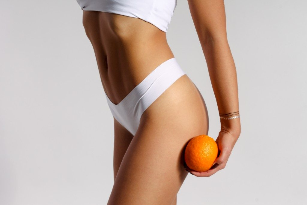 Fit woman with an orange