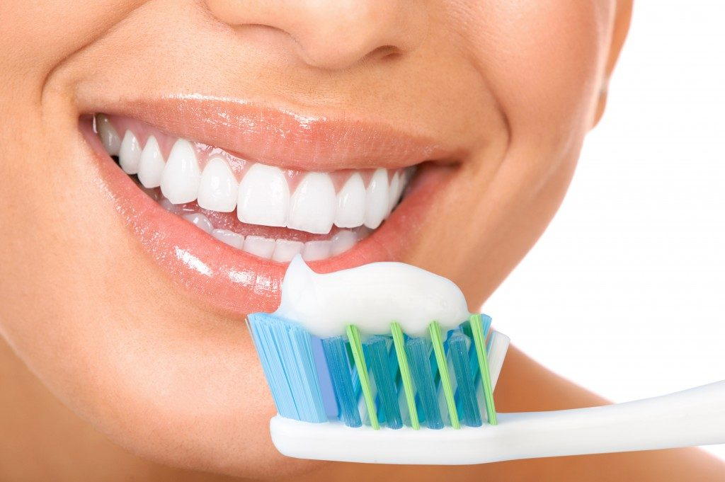 White teeth with toothbrush and toothpaste