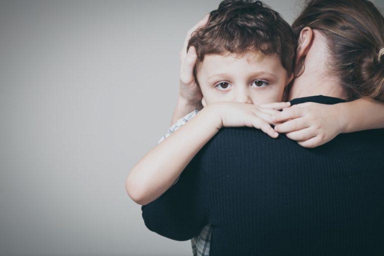 son hugging the mom