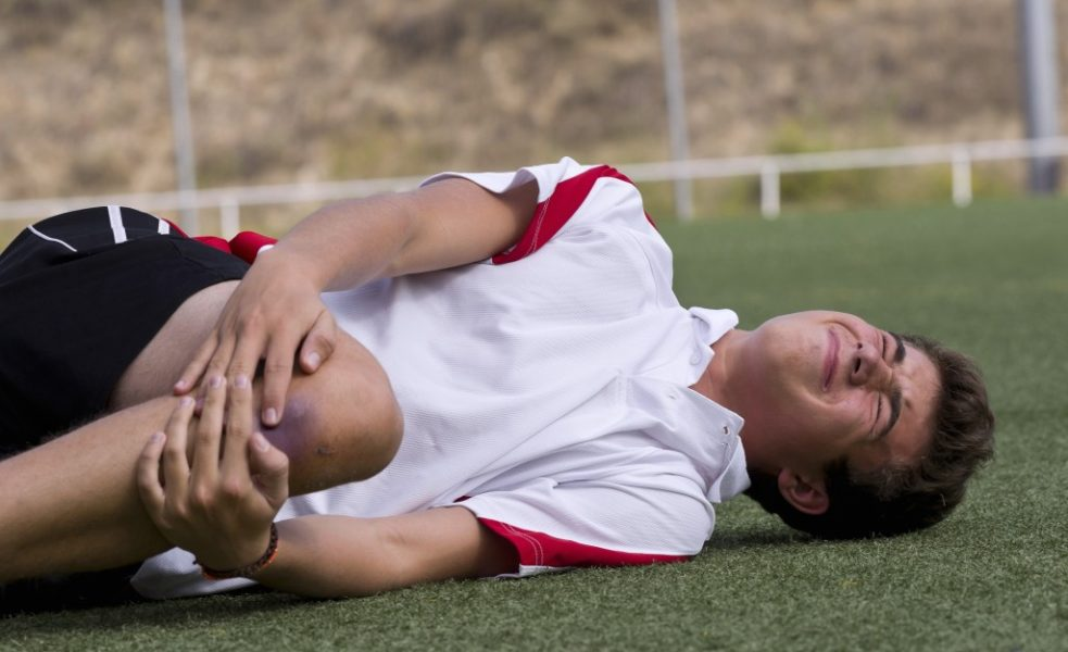 Player suffering from knee injury