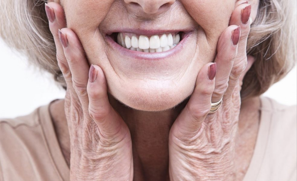 old woman showing her teeth