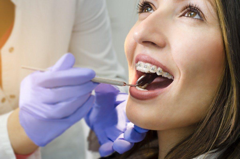 girl on dental braces check up