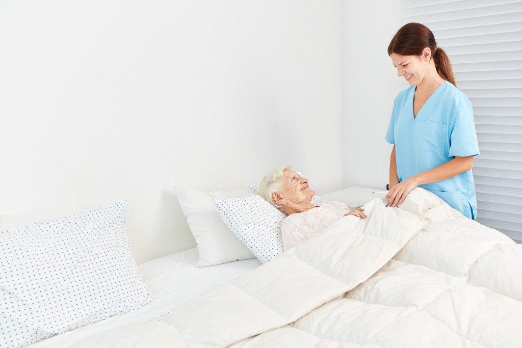 nurse taking care of an elder