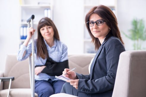 injured person talking to an executive woman