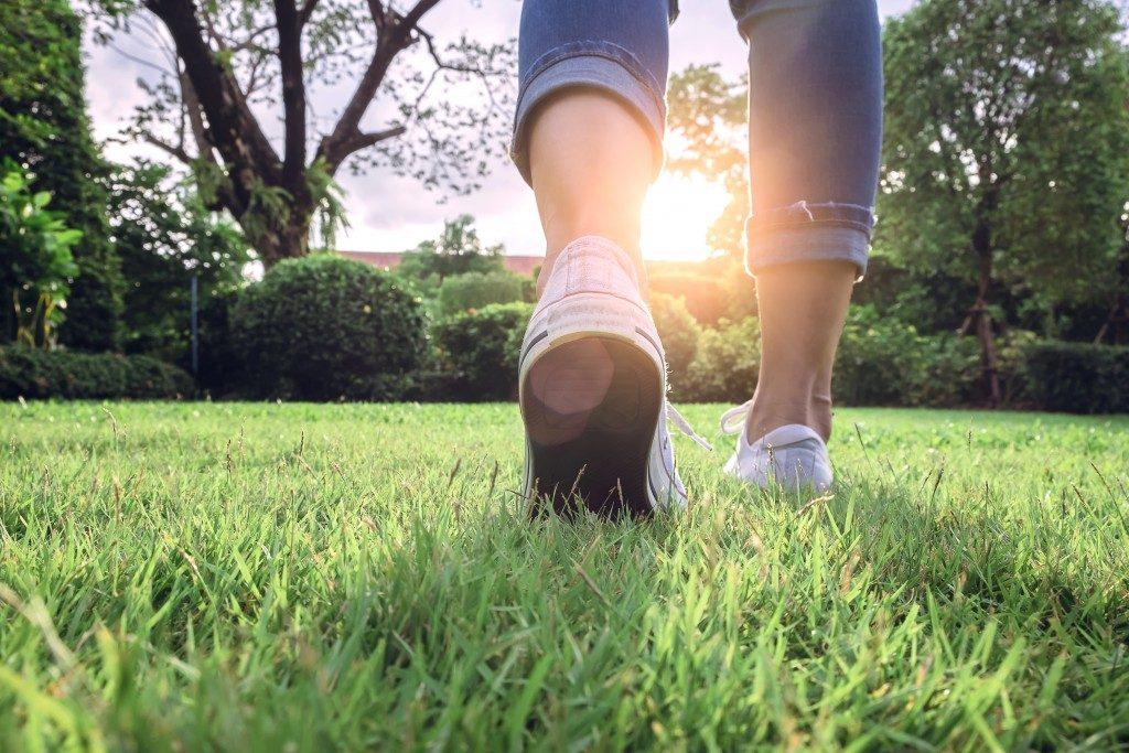 Close-up of feet walking