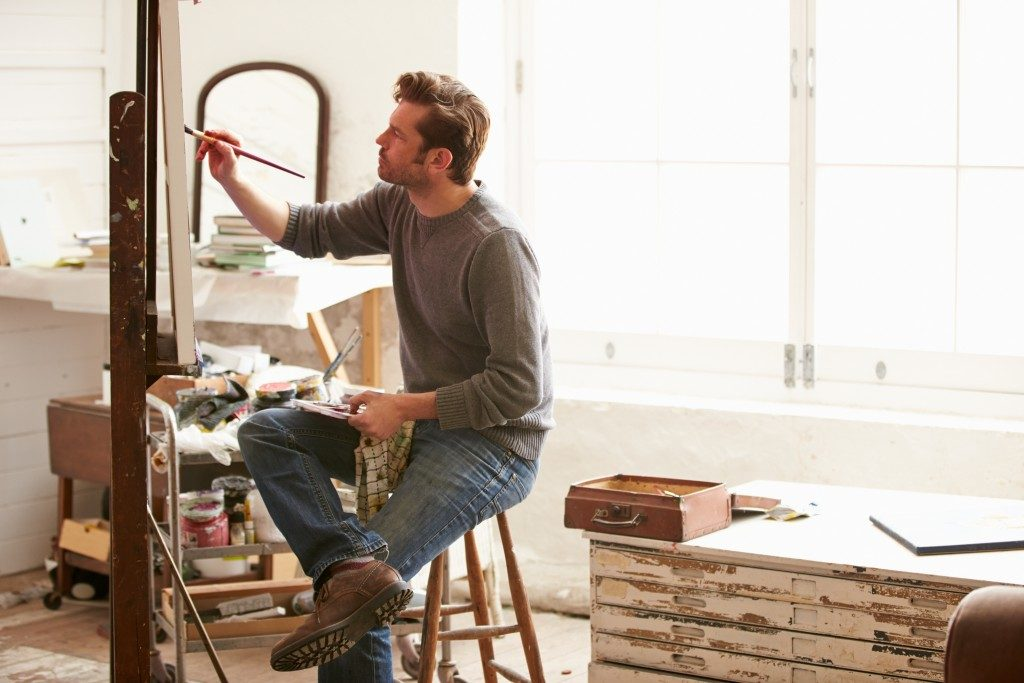 Man painting at an art studio
