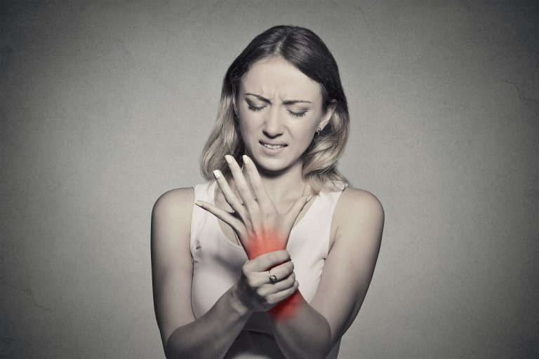 Woman whose hand is in pain