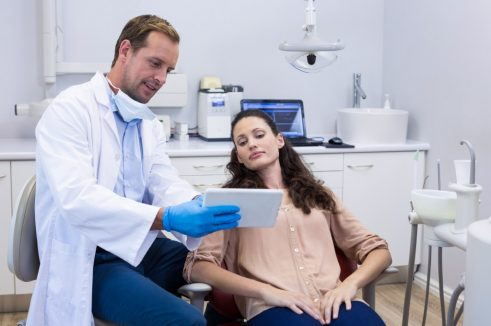 dentist showing an xray to patient