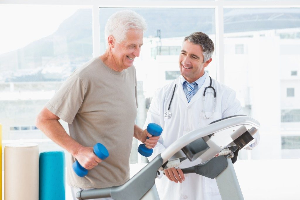 man with physical therapist