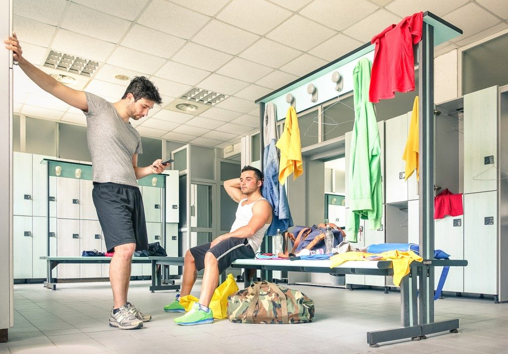 Young people at gym dressing room