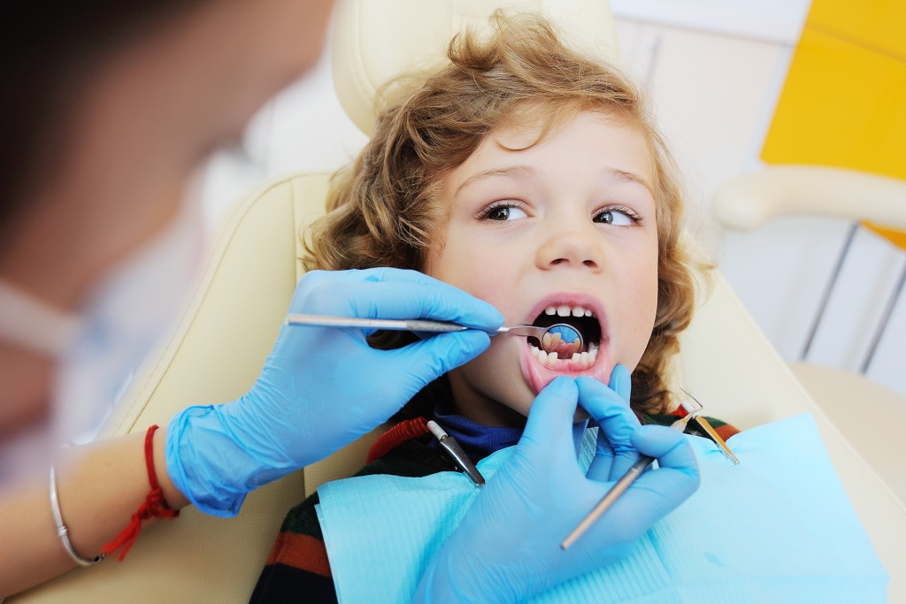 kid at a dental clinic