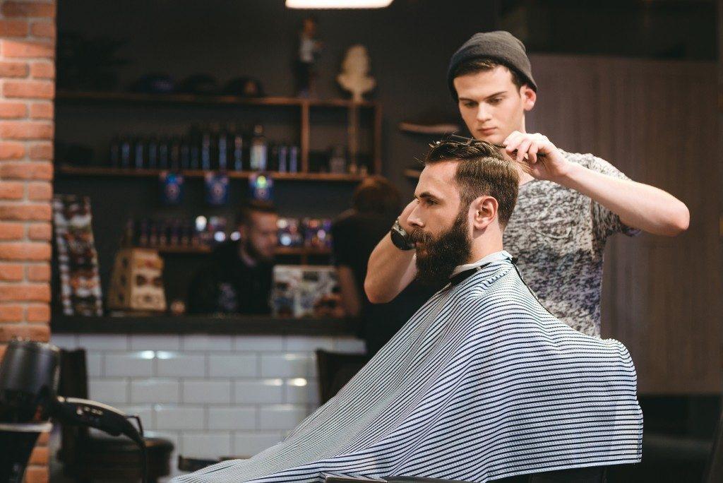 man getting hair fixed