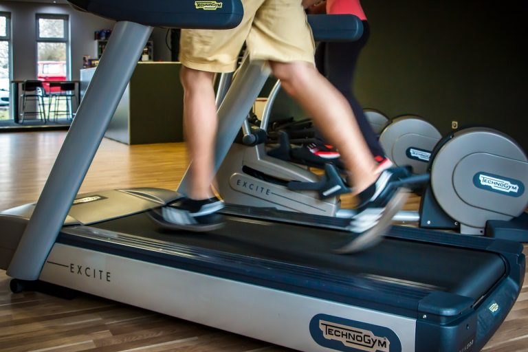 men using the treadmill at the gym