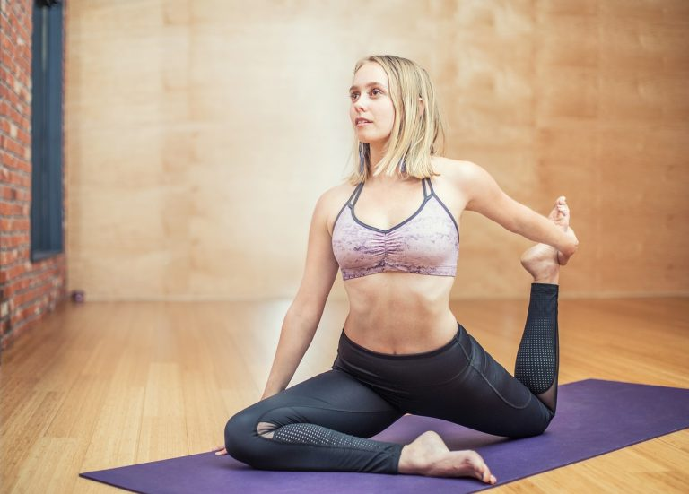 woman doing yoga before workout