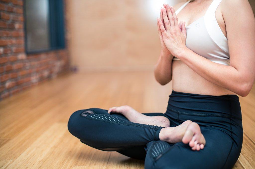 woman meditating after doing yoga