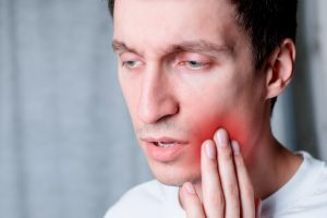 man suffering from dental pain