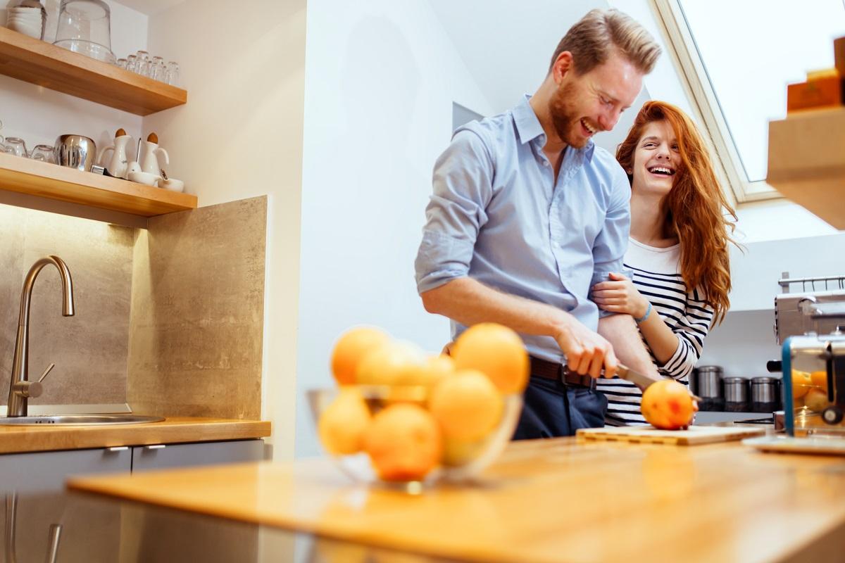 couple slicing fresh oranges