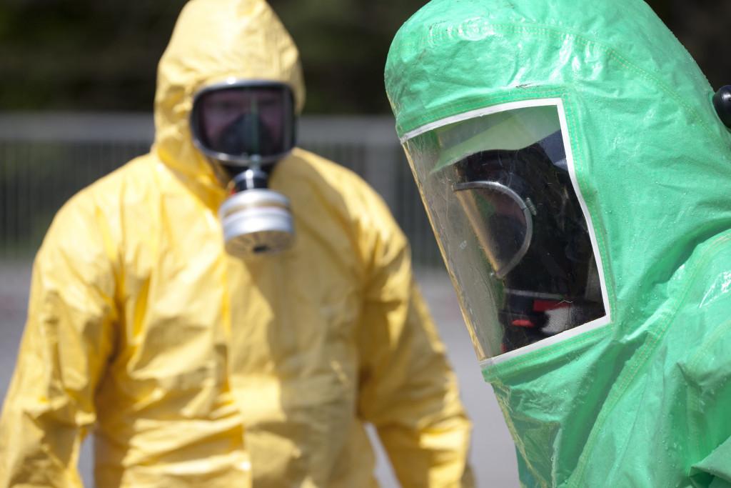 Men wearing safety gear against virus