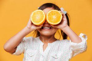 kid holding an orange